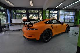 porsche wrapped 2016 porsche 911 gt3 rs gets retro look with racing orange matt