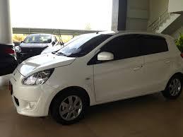 mitsubishi car white mitsubishi mirage a journey of many thousand miles