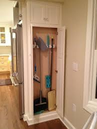 12 inch broom cabinet broom cabinet next to fridge our pantry which is 14 deep it opens