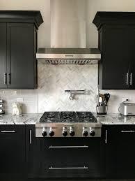 kitchen backsplash with cabinets and light countertops espresso cabinets with light grey subway backsplash