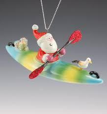 santa on a kayak santa claus figurines and carved wooden santas