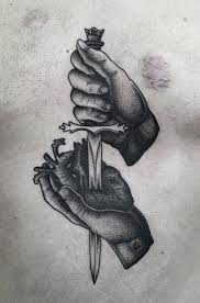 black ink sword in real heart tattoo design