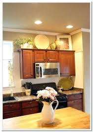 decorating above kitchen cabinets pictures ideas for decorating above kitchen cabinets cabinet s top photo