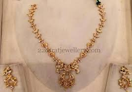 set of gold 28gms simple gold cz set jewellery designs