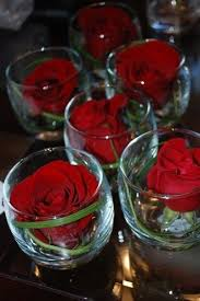 red roses in glasses make a simple but stunning centerpiece