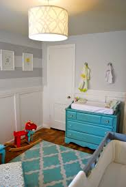 turquoise baby furniture with gray crib paired with yellow for