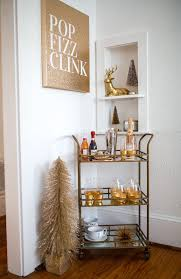 best 25 home bar decor ideas on pinterest giant jenga open holiday bar cart how to decorate your home for the holidays haute off the