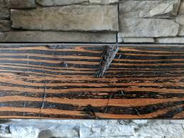 how to create a diy distressed wood beam mantle joyfully growing