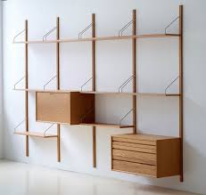 living room colorful wood bookshelves grey color wall modern
