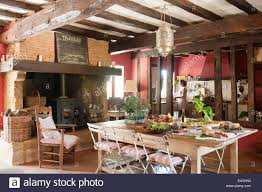 large rustic french country kitchen with old ceiling beams stock