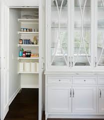 kitchen china cabinet glass front china cabinet next to walk in pantry transitional