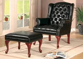 black vinyl button tufted wing chair w ottoman