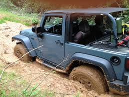 white jeep stuck in mud mud violating my warranty page 4 jeep wrangler forum