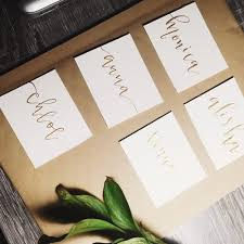 gold calligraphy place cards sunday studio