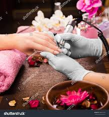 closeup finger nail care by manicure stock photo 386671636