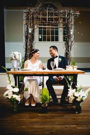 bride and groom sweetheart table and grooms rustic elegant wedding reception sweetheart table