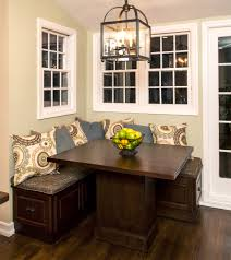 small kitchen nook design with dark wood table and corner