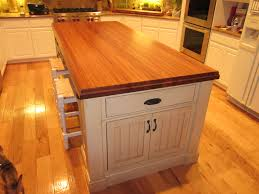 large modern white kitchen island with drawer and butcher block