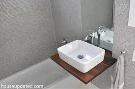 How To Install Bathroom Vanity by Gray White Bathroom Vessel Sink Penny Wall Tile Installing