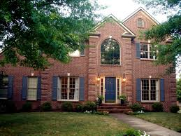 red brick house color schemes classic red brick house design with blue door ideas update built in