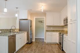 beautiful kitchen with white cabinets granite countertops
