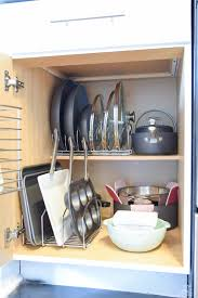 how to organize pots and pans in cabinet best way to organize pots and pans in cabinet page 1