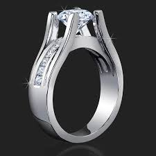 floating diamond ring wide band floating diamond tension mounted for maximum sparkle