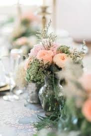soft peach and pink roses wedding flowers table setting decor