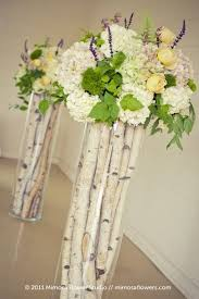 Flower Arrangements For Tall Vases Picture Of Birch Sticks In Tall Vases And Fresh Flowers On Top For