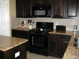 recent impressive dark kitchen cabinets with black appliances 900