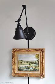 adjustable arm lighting fixtures adjustable arm wall light from a desk l the painted hive i