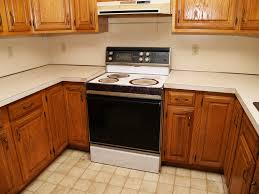 how to fix kitchen base cabinets to wall when should you replace your kitchen cabinets tops
