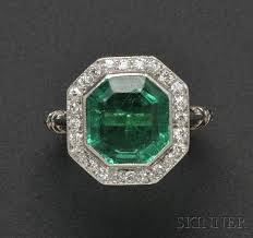 art deco platinum emerald and diamond ring t b starr bezel