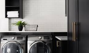Countertop Clothes Dryer Black Laundry Cabinets With White Subway Tiles Transitional