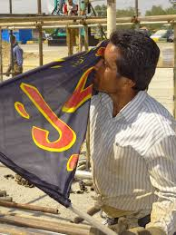 Outside Flag File Man Kisses Flag Of Third Shia Imam Outside Holy Shrine Of