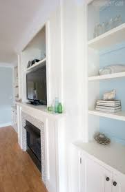 built in entertainment center and fireplace