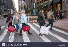 shoppers laden with their purchases in new york on sunday