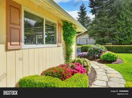 american yellow rambler style house exterior stock photo u0026 stock