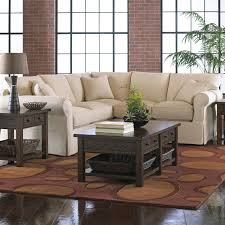 slipcover sectional with rolled arms and skirt by klaussner wolf