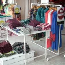 display tables for boutique modern custom clothing racks that help you sell garments