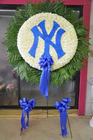balloon delivery bronx ny ny yankees logo funeral flowers custom funeral arrangement in