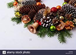 handmade wooden christmas jingle bell fir branches and pine cones