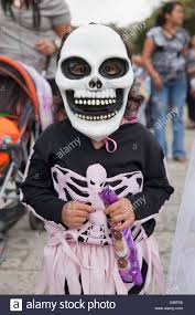 halloween costume mexican skeleton young wearing skeleton mask and costume for day of the dead