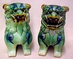 green foo dogs a pair of green glazed pottery foo dogs one with