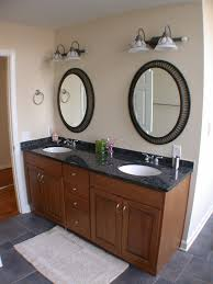 rectangle brown wooden bathroom vanity with double round white