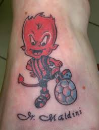 cute devil with football tattoo design on foot photos pictures