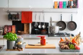 closeup on table with vegetables in kitchen stock photo picture