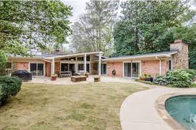 825k midcentury modern in buckhead boasts authenticity pool a backyard conducive to good times keller williams realty