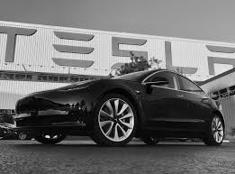 first tesla model 3 rolls off production line into the hands