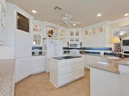 kitchen elegant kitchen design with white kitchen cabinets and elegant kitchen design with white kitchen cabinets and small kitchen island on tile flooring plus kitchen ceiling fans